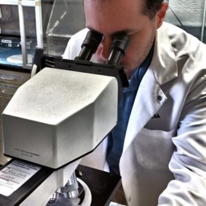 Christopher King with microscope